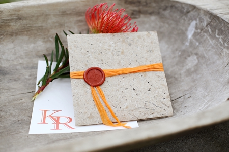 Wedding invitations with seal in burned orange colour