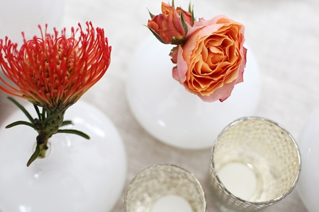 Table top decoration with Protea in burned orange