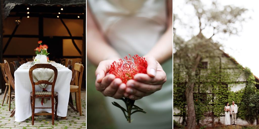 Ländliche Location, Braut hält Ringe auf Blume